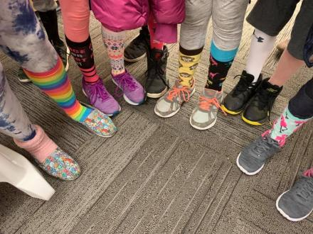 students wore crazy socks to commemorate World Down Syndrome Day